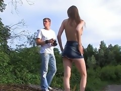 Sexy Beata is exposing her succulent shaved pussy during outdoor photo-shots