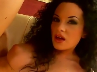 Amazing curly haired brunette bombshell Sybelle Watson with fascinating eyes poses and masturbates