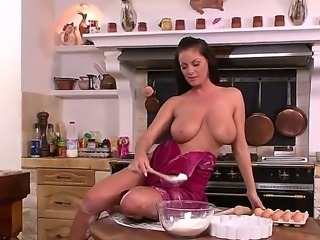 Shes-Our-Dessert with her huge clit open on kitchen