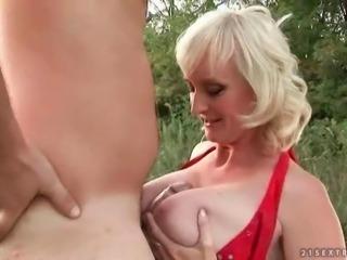 Hot busty grandma enjoys hard anal sex