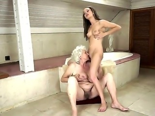 Blonde granny with sassy boobs and hairy pussy Norma having fun with slender...