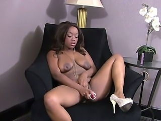 Busty hot ebony Roxy Pearl loves masturbating her wet pussy with a huge toy cock