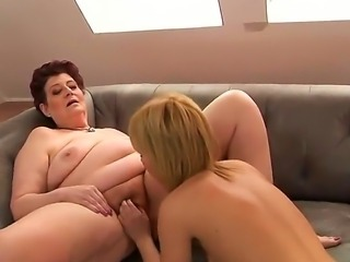 Redhead granny Eliz gets her pussy licked with a young sexy blonde babe Hetty as she moans
