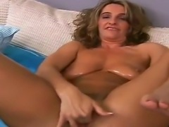 Busty brunette Tiffanee takes off her sexy panties and masturbates with a toy