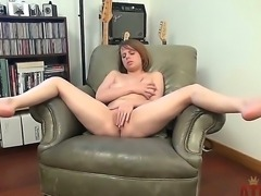 Shelly Starr is sitting in leather armchair and naughtily fingering her twat...