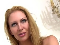 Pretty blonde Leigh Darby strips off her dress to reveal her busty tits and...