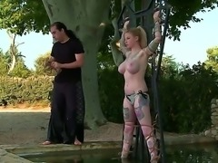 Hardcore outdoor fetish scene with a poor and horny blonde named Hollie Hatton