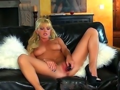 gorgeous blonde Niki Young likes posing when deep masturbating her wet and...