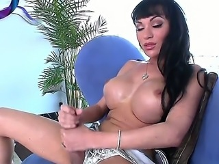 Fascinating shemale mistress Mia Isabella with huge boobs and sexy face jerks her dick