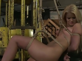 A gal punished by her mistress chained and her ass spanked hard.