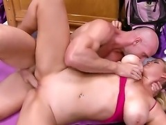 A big dicked guy gives a sexy horny blonde a steamy fuck session in her tight...