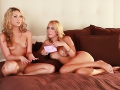 Brett Rossi does striptease before she sticks her fingers in her pussy