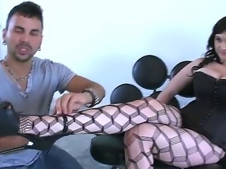 Big beautiful brunette woman Beverly Paige spends cool time with Voodoo. She stands on knees first of all and starts giving fellatio, handjob and titjob to the man.