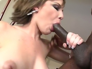 Smoking hot milf Katie St. Ives loves the taste of his hard black cock deep inside her mouth and pussy