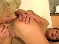 Young and mature Melane and Sally G are having intense pleasure in hot...