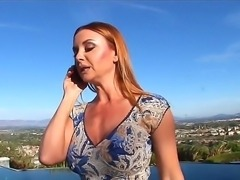 Sexy milf with great delicious boobs Janet Mason talks on the phone and looks...