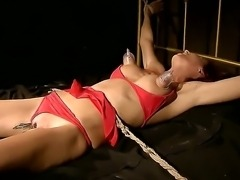 Nasty redhead slut Patricia Gold tied up and tortured with clips ,whips and...