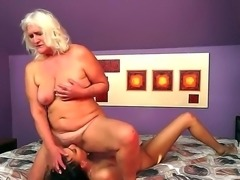 Lusty granny Judi is having fun licking young Lyen Parkers juicy shaved pussy