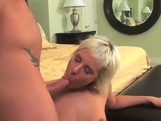 Seductive blonde babe Eve Nicholson receives a long, thick dick inside her tender booty. She suckles on that hard dick before taking a wild ride on it.