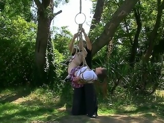 Gorgeous submissive bimbo Samantha Bentley is tormented by a kinky master in a forest. She is tied up and suspended under a tree before her master sets her free.