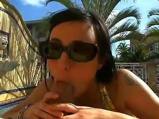 Sweet chick Pyrah Lee munches on a hard cock next to a pool. Afterwards she continues her duty inside her mans room and receives his dong down her bald pussy.
