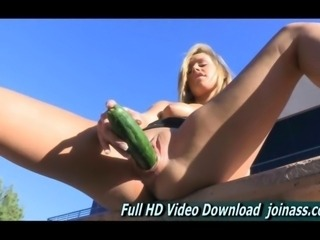 Blonde teen Kennedy masturbates with a cucumber in public