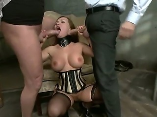 Cock hungry submissive brunette Katja Kassin with big round tits in corset and stockings gets stunning firm ass drilled deep by Steve Holmes and Mark Davis in kinky bondage session.