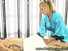 Sexy masseuse sucks client cock