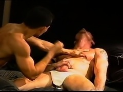 Hot hung smooth muscle stud has balls punched and squeezed by a hot smooth...