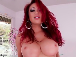 Redhead exotic Mia Lelani has fun with vibrator