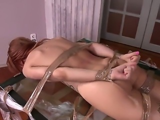 Petite young redhead doll Leyla Black with provocative tattoos wrapped in nylon gets throat fucked deep by randy muscled stud and gets her tight sweet ass creampied in kinky fantasy.