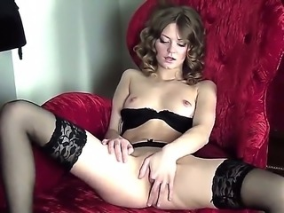 Horney sexy brunette in white stockings shows off her wet flawless pussy in a red velvet couch