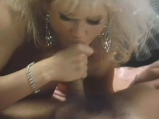 Classic porn legend Amber Lynn stars as a robot lover in the 1990 movie Ultimate Lover. Amber fucks Eric Edwards in this scene.