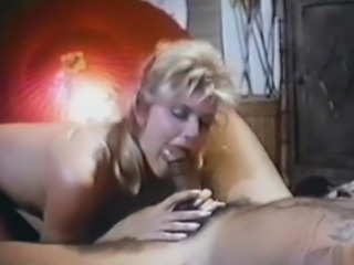 Porn legend Ginger Lynn goes to a tattoo parlor for some ink, but ends up getting a rear end fucking from Herschel Savage.