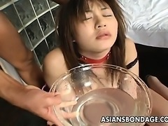 Kinky Asian slave babe licking and drinking pee.