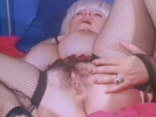 Big boob vintage babe Candy Samples is wearing mesh lingerie during her masturbation session. Candy lays down on the bed, sprawls out and plays with her pussy until she cums.