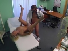 Doctor with gloves fingering and fucking a blonde in office