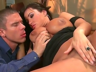 Busty and turned on brunette honey Lisa Ann gets her shaved taco licked in...