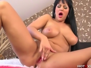 This latina beauty has an hour glass figure that will entice you. Carmen Croft is a voluptuous milf that loves to masturbate pleasure herself.
