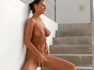 Stunning black haired sporty goddess Adria with perfectly shaped natural perky knockers and jaw dropping firm bums gets naked while teasing on staircase and pleasures herself in outdoor fantasy.