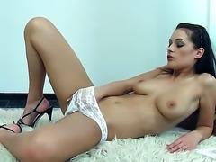 Seductive hottie Dana Weyron poses in white panties before teasing her sweet...