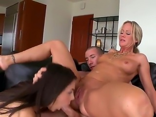 Filthy blonde milf Simone Sonay with natural tits and great hunger for pussy lick pretty heavy chested Valentina Nappi while young tall stud is drilling her ass deep on leather couch.