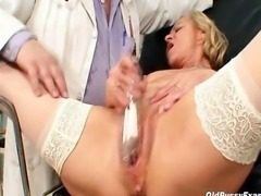Filthy woman doctor checking blond grandma pussy on gynchair. He is using...