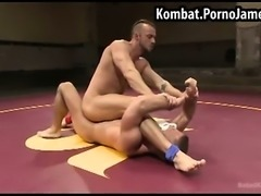 Oiled up men wrestling