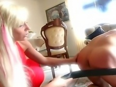 Blonde tattooed mistress whipping and spanking her naughty slave