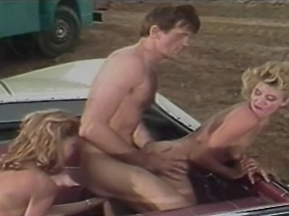 Ginger Lynn and her girlfriend stop at a gas station to ask for help. What they get is fucked by a blue collar stud with a big dick. Ginger enjoys a rear end fucking in the vehicle.