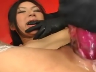 Chihiro is tied in Japanese Bondage Rope Suspension and her captors rip off her clothes and make her cum with large vibrators.