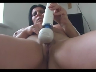 busty milf teases in her office and she fucks herself