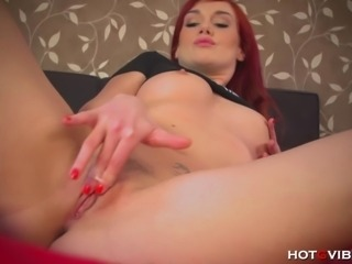 Sexy, redheaded Czech babe plays with her HotGVibe, fingering her pretty, little shaved pussy and succumbing to the powerful vibrations until she experiences a throbbing orgasm.