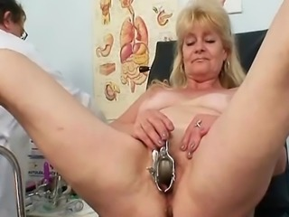 Blond granny visits gyno clinic to have her old pussy checked with speculum. The kinky doctor performs an enema with milk